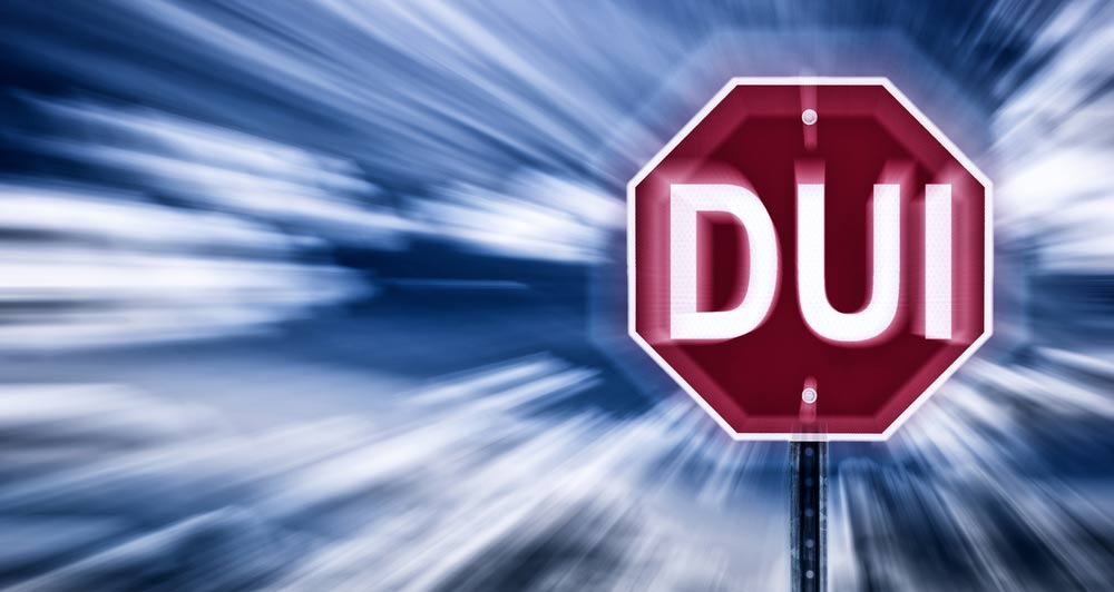 A stop sign that says DUI.