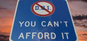 "A sign that says, ""DUI, You Can't Afford It""."